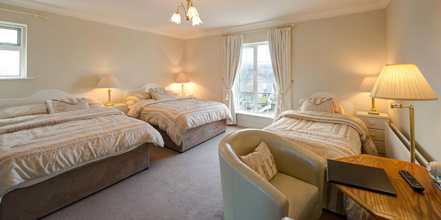 Family Room - A room with one double bed and two single beds or two double beds, suitable for a family of four.
